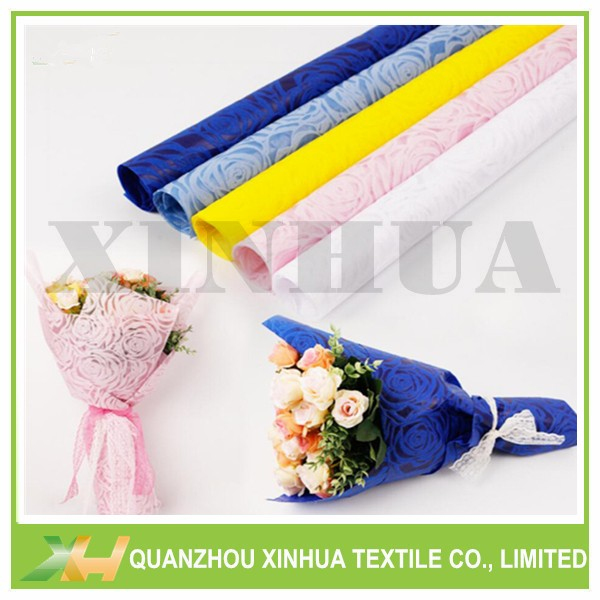 Wholesale newly embossed pattern rose nonwoven flower fabric