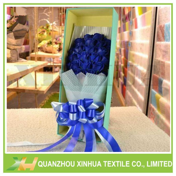 Wave embossed pp spunbond nonwoven for flower wrapping