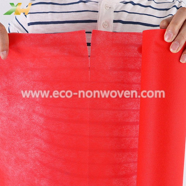 Xinhua factory supply red nonwoven tablecloth pp spunbond, tnt nonwoven