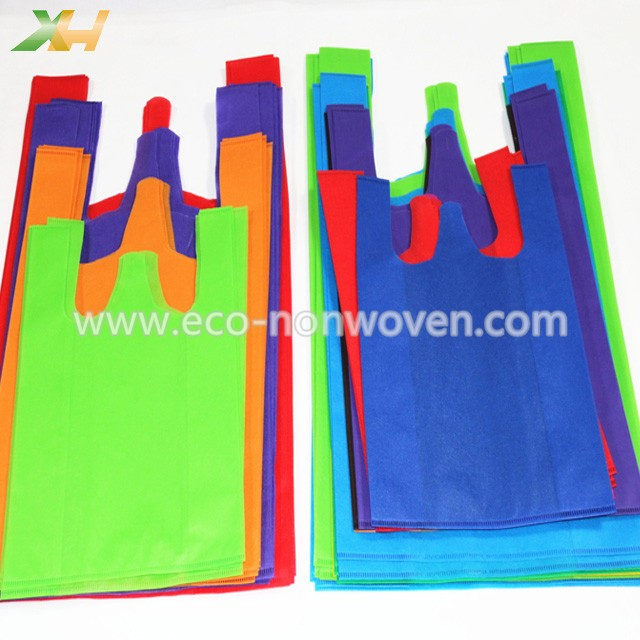 Cheap price colorful stocklot non woven t-shirt bag/ non woven vest bag